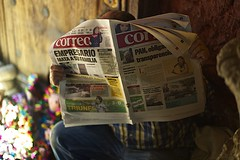 toy vendor's morning read.. (camelot98.) Tags: street leica city travel light urban color mexico newspaper colorful dof bright bokeh f14 candid streetphotography rangefinder sanmigueldeallende guanajuato manual summilux asph m9