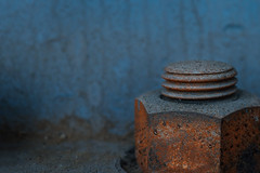 Corrosive rusted bolt (TouTouke - Nightfox) Tags: old blue industry rotting metal wall turn outdoors screws construction rust iron pattern steel grunge nuts machine rusty plate twist surface cargo dirty machinery part level frame bolt backgrounds bolts rough dust gears copy wrench textured obsolete rundown rivet uneven ruien