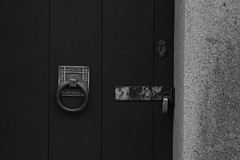 Don't Come a Knockin' (Scotty Slates) Tags: door old bw white black monochrome canon handle pattern craft knocker aged dslr knock craftsmenship canon650d