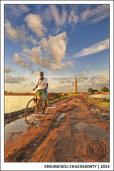 Untitled (engineer112) Tags: street red chimney sky india west brick field wheel clouds lens photography nikon child shot angle mud labor bricks wide soil cycle nikkor puddles kolkata ultra bengal 1835mm waterbody