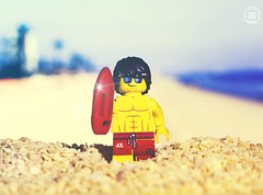 Baywatch (jezbags) Tags: baywatch lego legos minifigure minifigures sunshine beach lifeguard sea sand glasses running canon60d canon closeup upclose 100mm yellow blue red shorts day light warm happy