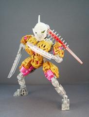 Freya - Combat (0nuku) Tags: bionicle lego toa crystal quartz pink gold clear crast kanohi custom mask prosthetics amputee