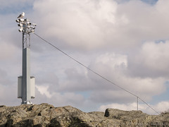 CCTV Operator (swedeshutter) Tags: seagull surveillance cameras sky rocks antenna wire clouds bird control ccd camera lumix panasonic g80 1260