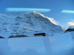 ...EigernOrdwand... (project:2501) Tags: wengen jungfrauregion suisse switzerland snow ski travel view aroomwithaview theviewfromhere viewthroughawindow windowseat window windowreflection clouds lightcloud sky skyblue snowblue fluorescentlight bluelight blue bluebleu bleu inthemountains mountains mountain rock eigernordwand theeiger3970m
