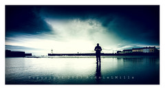 Even Grey Days Can Be Interesting (RonnieLMills) Tags: donaghadee harbour lighthouse low tide lone figure silhouette reflections