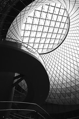 dislocation (Joseph Dimartino) Tags: blackandwhite bw building architecture city light web street streetphoto skylight sky entry grid monochrome abstract fultoncenter nyc view windows