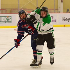 """friendly"" meeting (R.A. Killmer) Tags: hockey ice skate sru puck shot acha green white tough hit competition"