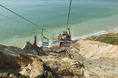 Down To The Sea (crashcalloway) Tags: chairlift sea shore cliffs alumbay totland iow isleofwight nature descending goingdown