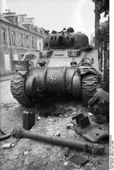 "Sherman tank has met its demise in the streets of Villers-Bocage • <a style=""font-size:0.8em;"" href=""http://www.flickr.com/photos/81723459@N04/13932022474/"" target=""_blank"">View on Flickr</a>"