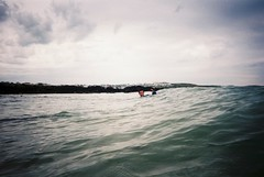 Snorkling around Newquay (imogencallaway) Tags: camera pink blue sea sky film water clouds 35mm cornwall fluffy newquay waterproof disposable