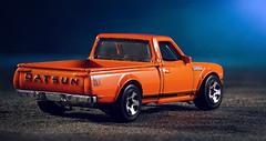DATSUN - My first focus stacking effort (Ilkka Hakamäki) Tags: lighting blue orange hot macro car toy nikon focus flash wheels setup 28 stacking dat tamron 90 datsun strobe strobist yongnuo d7000 rf603 yn560ii yn560iii