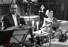 The Drummer and the Jazz Singer (Halcon122) Tags: bw woman private 50mm candid young jazz reception singer drummer olympusepm2