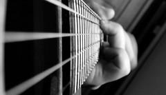 Close-up of guitar playing (Media Viking Snaps) Tags: bw selfportrait playing closeup artistic guitar acoustic strings 1020 dreadnought lumia