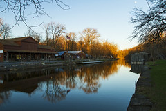 Erie Canal - Camillus, NY (Matt Champlin) Tags: monday eriecanal sunset spring springtime history historical camillus cny fingerlakes ny 2017 evening peace peaceful tranquil old locks stores commerce transportation waterways reflection glow moon