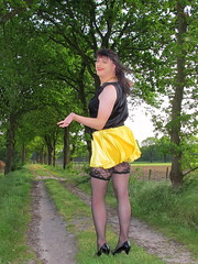 Perfect display (Paula Satijn) Tags: sexy hot girl skirt miniskirt satin silk silky shiny yellow gurl tgirl black outside tree spring smile fun joy happy legs stockings lace stockingtops lacy sensual