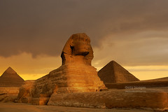 Sunset at the Sphinx and Pyramid complex Giza, Egypt. (Nick Brundle - Photography) Tags: africa ancient ancienthistory archaeology architecture cairo capitalcities classical cloudscape desert distant dusk egypt egyptianculture famousplace giza gizapyramids internationallandmark kheopspyramid middleeast oldruin pyramid pyramidofchephren pyramidofmycerinus red shrine sphinx sunset thesphinx tomb tourism travel traveldestinations unescoworldheritagesite gettyimages nikond750 nikon24120mmf4