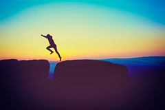 The Jump (iratebadger) Tags: nikon nikond7100 nikkor nikonphotography sunset sun sundown sky shadows solitary skyscape sunlight rocks jump jumping yorkshire westyorkshire blue outside outdoors orange orangehour gap person