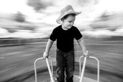 A little spin on panning (pun intended) (tonyajbender) Tags: spinning panning motion playground minimalism nephew children child kid blackandwhite photochallengeorg photochallenge2017