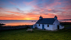 Golden moment ( In Explore ) (Einir Wyn Leigh) Tags: landscape seascape sunset wales anglesey cymru love beauty orange fire sky sun colour beach cottage house ocean water sand coast blue green natural nature outdoor trip vacation holiday march sunlight warm