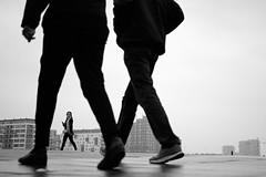 Framed walk (Bjarne Erick) Tags: framed walk boys girl headphones listening street fuji xt2 35mm 20 f2 blackwhite blackandwhite bw noirblanc