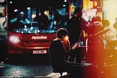 He saw the light (Panda1339) Tags: london uk zeissaposonnart2135 flare nikondf zeiss aposonnart2135 carlzeiss streetphotography bus night bokeh drummer oxfordstreet experimental flickrapp notlensflare 135mm