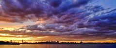 Sunset over Boston (ronperry811) Tags: boston cityscape seascape sunset clouds topaz skyline