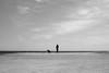 Down on the Jetty, Barcelona (Geraint Rowland Photography) Tags: blancoynegro blackandwhite artisticphotography wwwgeraintrowlandcouk beach water ocean sunshine woman streetphotography candidportrait minimalism sky clouds dog dogwalker geraintrowlandbarcelona barcelona catalonia spain europe