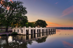White Boathouse (spanjavan) Tags: morning sky lake reflection tree water clouds sunrise vr