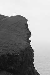 alone at the edge (backpackphotography) Tags: ocean ireland bw cliff coast clare alone cliffs cliffsofmoher westcoast moher countyclare 100400 backpackphotography