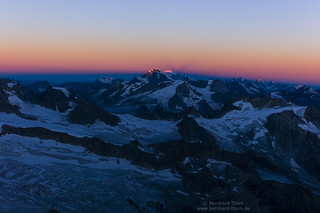 Sunrise over Arolla alps and Montblanc at ascent to Dent Blanche