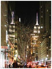 Empire Twice (lefeber) Tags: city nyc newyorkcity trees windows urban newyork reflection architecture night lights vanishingpoint downtown skyscrapers perspective empirestatebuilding