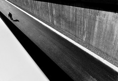 (Svein Nordrum) Tags: road old light shadow blackandwhite bw white man black lines silhouette concrete angle path perspective line explore passage linear distagon explored monomonday
