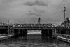 (McQuaide Photography) Tags: city bridge blackandwhite bw holland building water netherlands monochrome amsterdam architecture canon eos blackwhite europe nederland structure brug dslr stad 100d mcquaidephotography