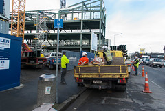 Having A Meeting of Minds (Jocey K) Tags: street newzealand christchurch sky people signs cars architecture clouds truck buildings bin stairway cranes constructionsite victoriast roadcones knoxplazabuild