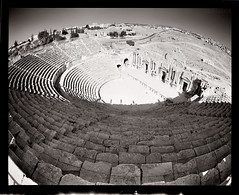Three of Us (tsiklonaut) Tags: travel shadow people white black 120 film blanco analog y theatre pentax roman drum south negro wide steps amphitheatre scan fisheye shade experience empire round syria roll medium format 100 analogue 6x7 iconic ultrawide 67 circular analogica chs teater discover  rooma amphi bosra drumscan analoog pmt theathre  adox   amphitheathre amfiteater  photomultipliertube  sria