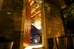 Doorway to Fun (M Brian M) Tags: cars austin fun garage motorcycles bicycles subaru wrx crowded buell mountainbikes 1125cr