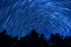 Star Trail in North Carolina (skiserge1) Tags: travel blue light sky mountain motion mountains tree texture nature night dark way stars landscape star long exposure track time outdoor background space horizon north trails northcarolina grand scene science canyon clear ridge trail galaxy astrophotography parkway carolina astronomy outer starry lapse constellation sergeskiba