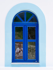 Portrait of a Photographer (Rupert Brun) Tags: blue portrait selfportrait reflection church window self island may greece ithaca selfie 2014 ionian kioni peloponnisosdytikielladakeio peloponnisosdytikielladakeionio