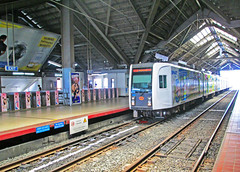 LRT 3g at Monumento Station (Next Base v150) Tags: smart station ads monumento santos lrt czeon