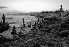 Inuksuit at English Bay, Vancouver, Canada (T Power) Tags: blackandwhite bw canada vancouver canon bc sundown dusk britishcolumbia tourists seawall englishbay inukshuk rockybeach nightfall freighters greyscale inuksuit