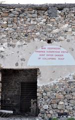 Santorini Greece - door and sign (stevelamb007) Tags: door roof sign nikon santorini greece telephoto nikkor derelict oldbuilding 18200mm d90 stevelamb vlychada