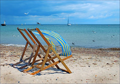 Sea Breezes (jo92photos) Tags: chair beach swanage deckchair vacant wind