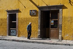 under the mexican sun.. (camelot98.) Tags: street leica city shadow urban man color colour texture lines yellow mexico bright streetphotography sunny sanmigueldeallende walls minimalistic x2 elmarit