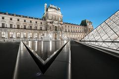 Meeting Point (McQuaide Photography) Tags: paris france french républiquefrançaise iledefrance europe sony a7rii ilce7rm2 alpha mirrorless 1635mm sonyzeiss zeiss variotessar fullframe mcquaidephotography adobe photoshop lightroom tripod manfrotto light availablelight bluehour twilight dusk longexposure city capitalcity urban lowlight outdoor outside architecture building wideangle wideanglelens modern modernarchitecture water reflection pyramid geometry shape form geometric louvre muséedulouvre courtyard historic museum landmark icon famous travel tourism culture cournapoléon court impei glass metal triangle triangular sharp point pointed nopeople empty deserted