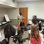 Bheki Madela, Ph.D. student, presents a workshop on Zulu at A Taste of Language, International Week at Illinois