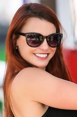 Million Dollar Smile (wyojones) Tags: texas tomball tomballgermanheritagefestival festival german people girlwoman redhead beautiful pretty cute lovely beauty server sunglasses shades smile wyojones
