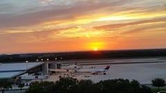 Airport Sunset (Michel Curi) Tags: sunset airport landscape tampa tampabay tampaairport florida lovefl sky clouds sun ktpa tpa airplanes runway horizon