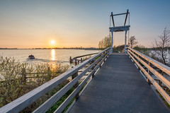 Meije Bridge At Spring Sundown (ShutterBasset) Tags: meije bridge polder nature plassen nieuwkoop lake spring sunset sundown sun water trees boat reflection clearskies clearweather netherlands nikon d5200 tokina cokin