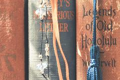 Orange & Blue (Carrie McGann) Tags: books bookmarks vintage kinfolk pearlsbuck nancysmysteriousletter nancydrew carolynkeene legendsofoldhonolulu wdwestervelt orangeandblue macromondays 040317 nikon interesting