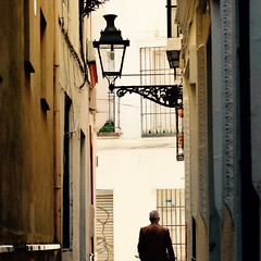 Streets of Seville! Seville Spain (saadia_khans) Tags: man afternoonlight spainlove alley lamppost street travelphoto travelphotography sevillia seville spain travel instagramapp square squareformat iphoneography